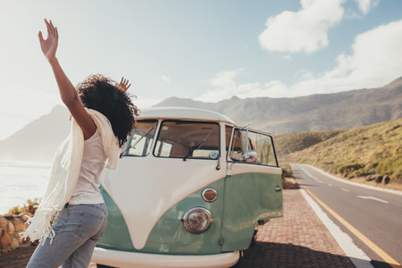 Woman having fun on road trip