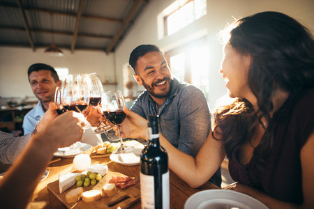 Cheerful celebrating with wine at party