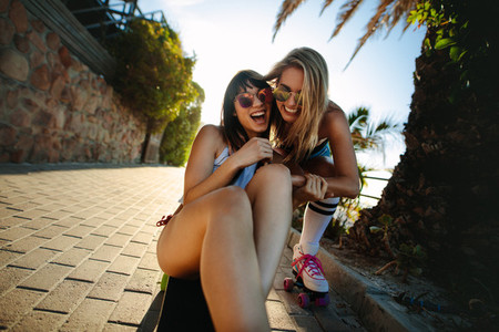 Cheerful female friends having fun outdoors