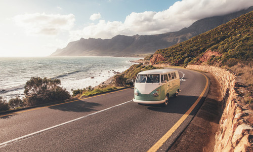 Mini van on coastal road