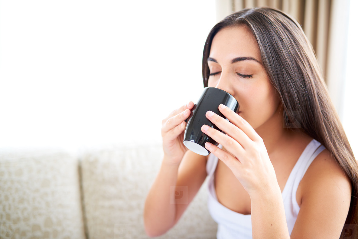 Close up of woman enjoying a warm drink