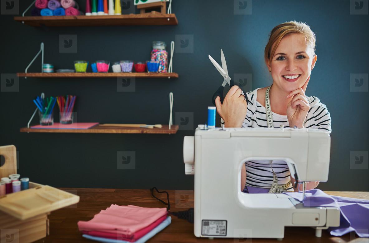 Happy female designer sitting at desk