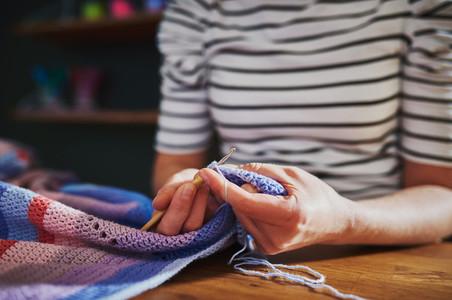 Woman sewing closeup