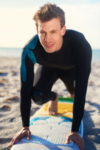 Surfer demonstrating a surfing pose on his board