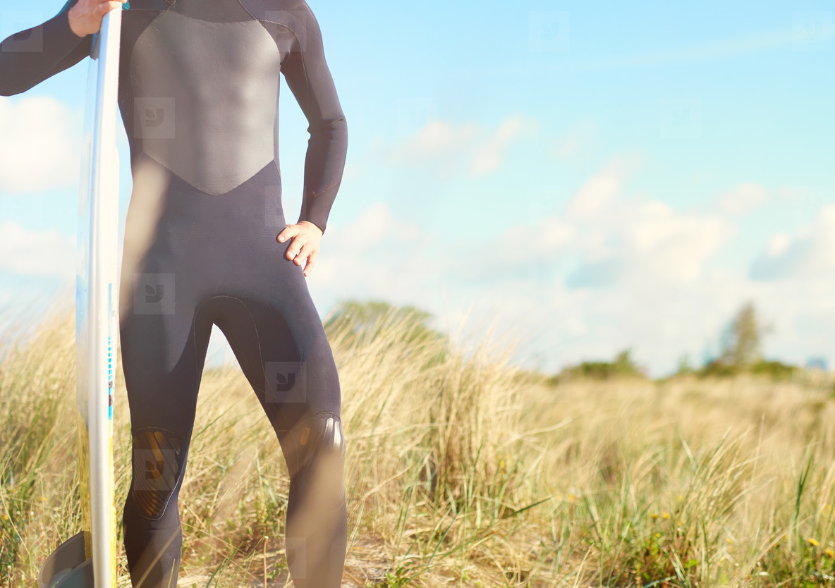 Torso view of a fit muscular surfer
