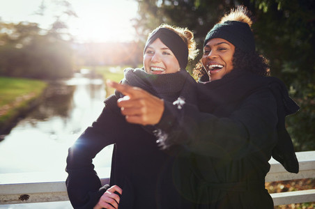Two girlfriends laughing at something