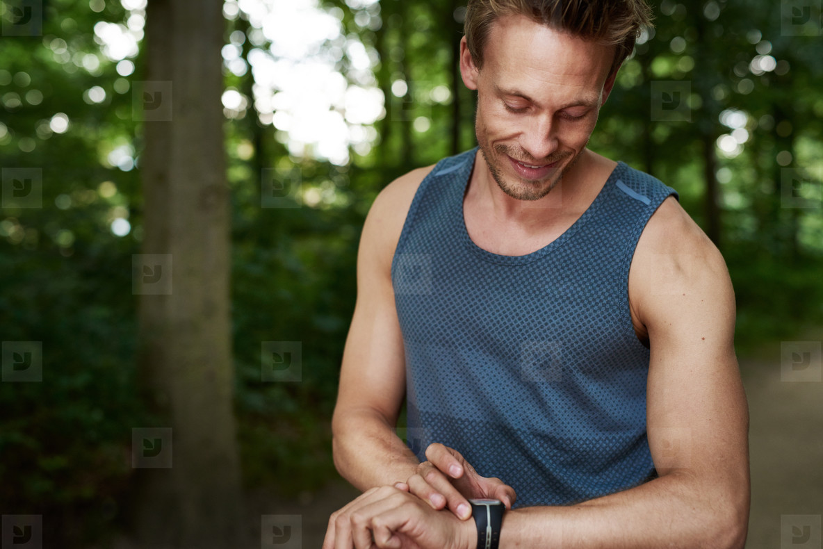 Man Looking at his Watch While in Outdoor Training