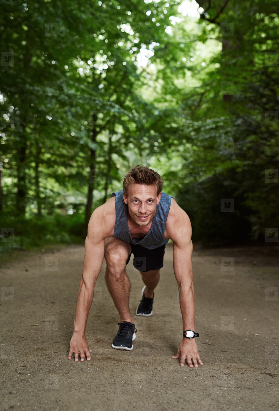 Portrait of male athlete standing in crouch position