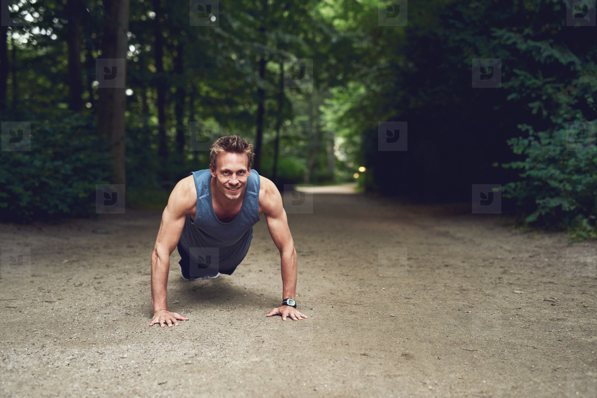 Male athlete doing push ups