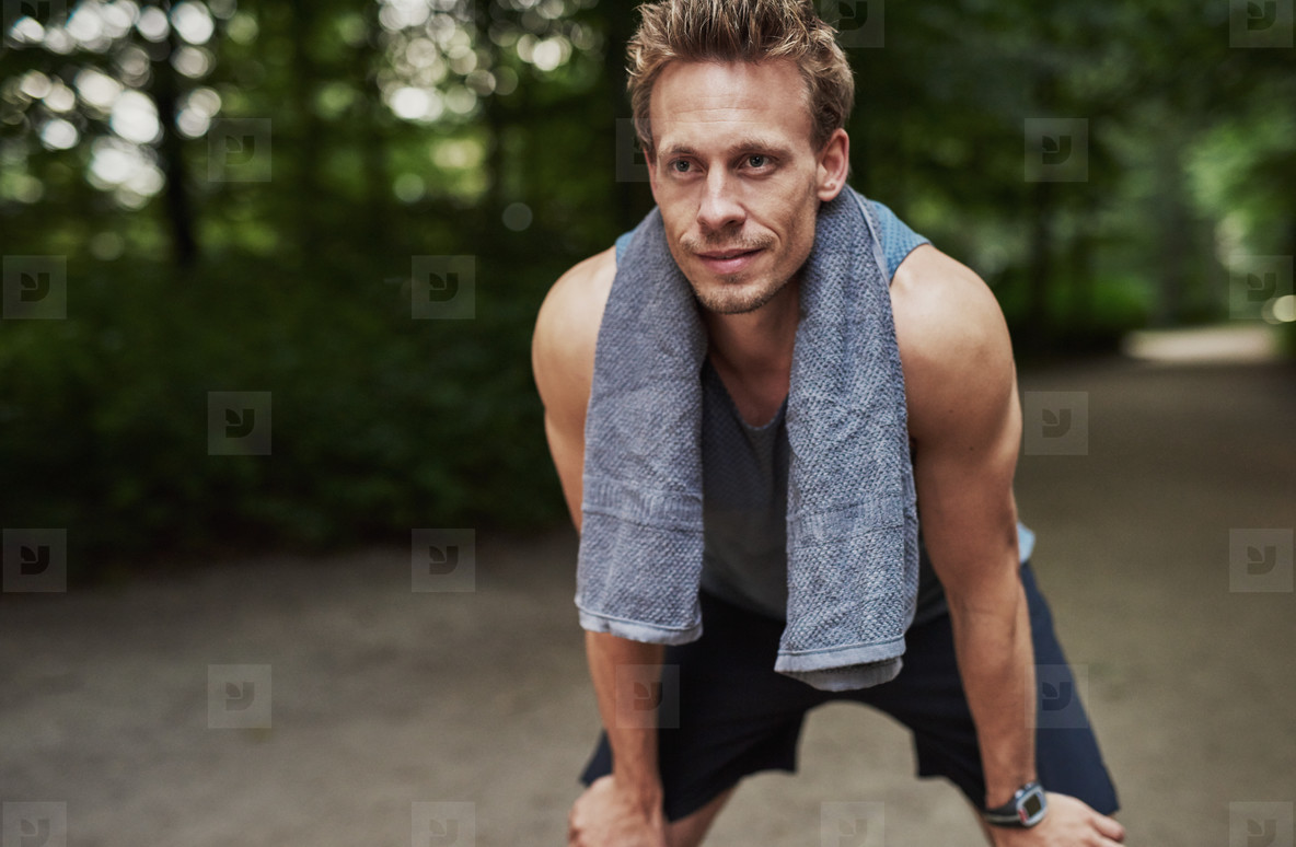 Athletic Man Resting After Jogging at the Park