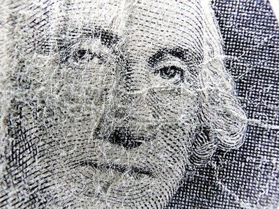 Closeup George Washington on one dollar bills