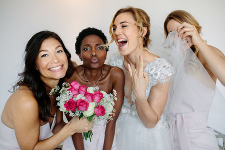 Cheerful bridesmaids with the bride on wedding day
