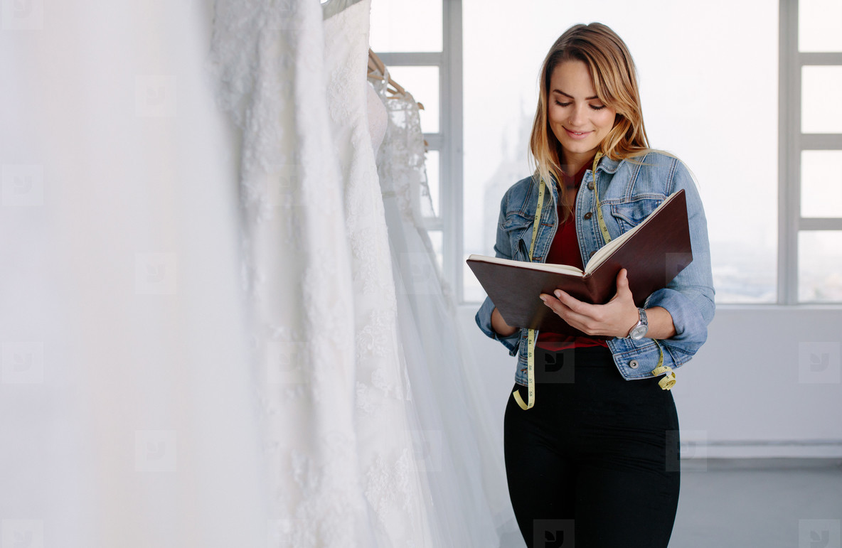 Dressmaker working in bridal clothing store