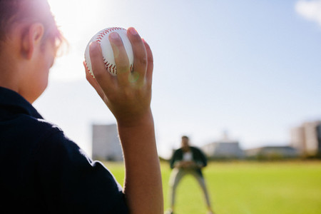 Boy playing with a baseball at a park