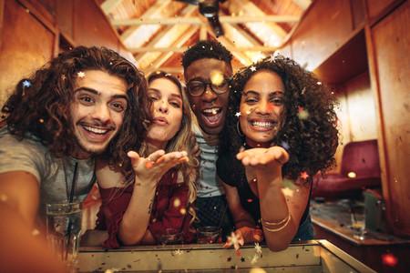 Friends capturing the fun in selfie at nightclub