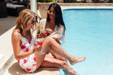 Best friends enjoying at resort poolside