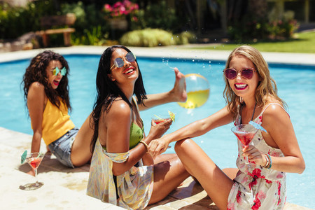 Women having great time at poolside party