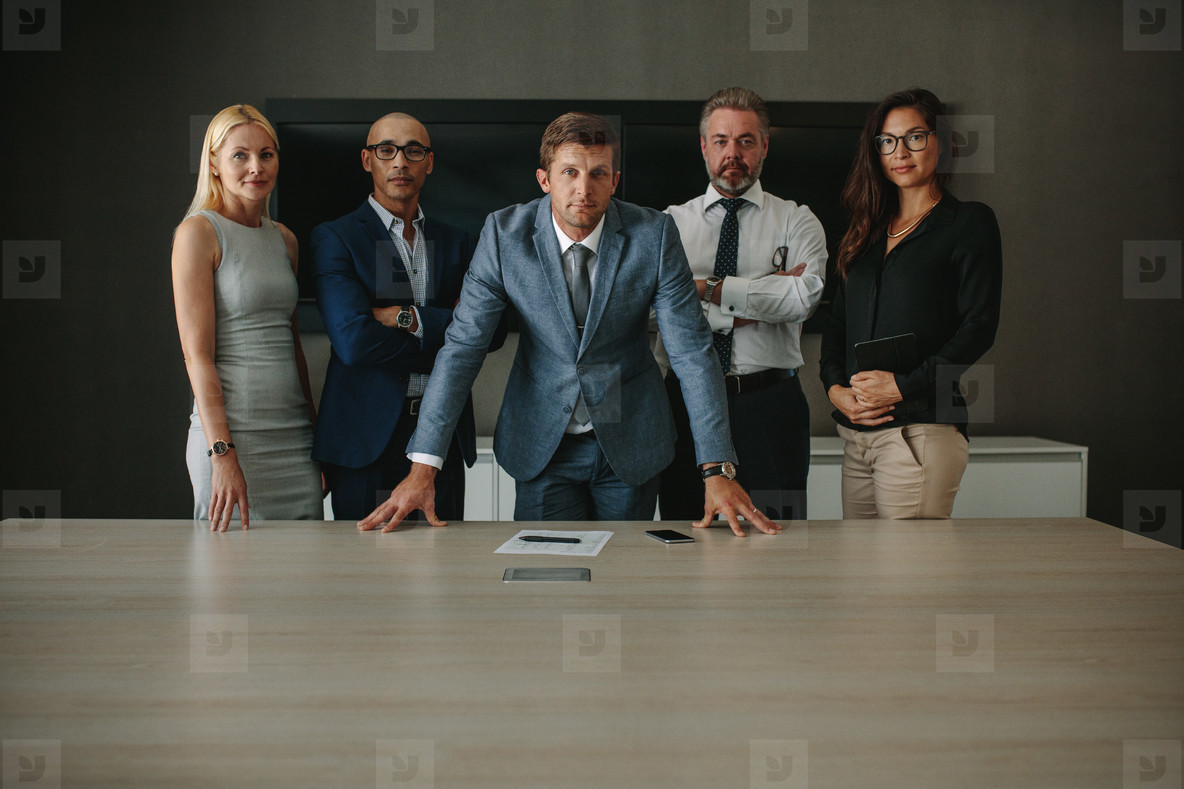 Confident corporate professionals in meeting room
