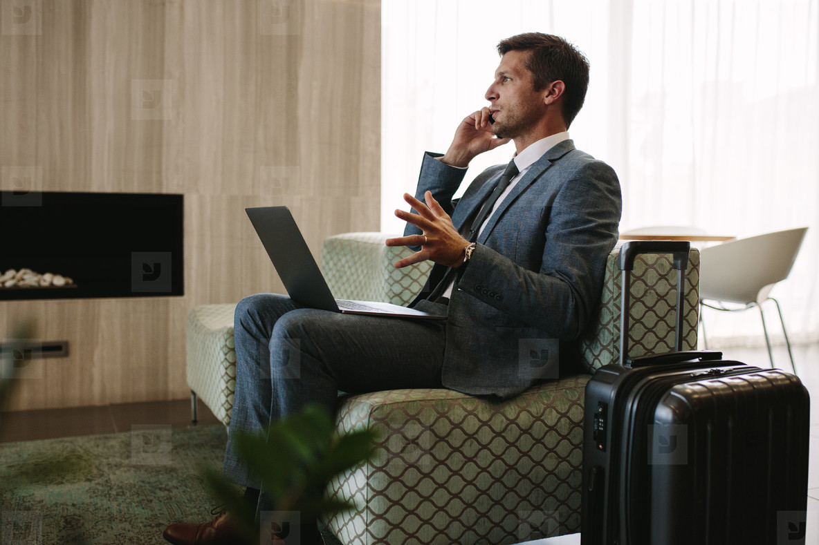Businessman waiting for his flight at airport lounge