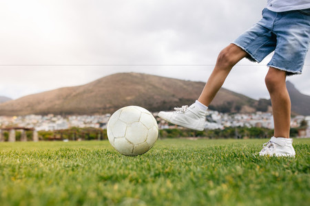 Boy playing football in a park