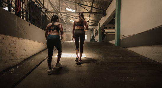 Women going in the cross training gym