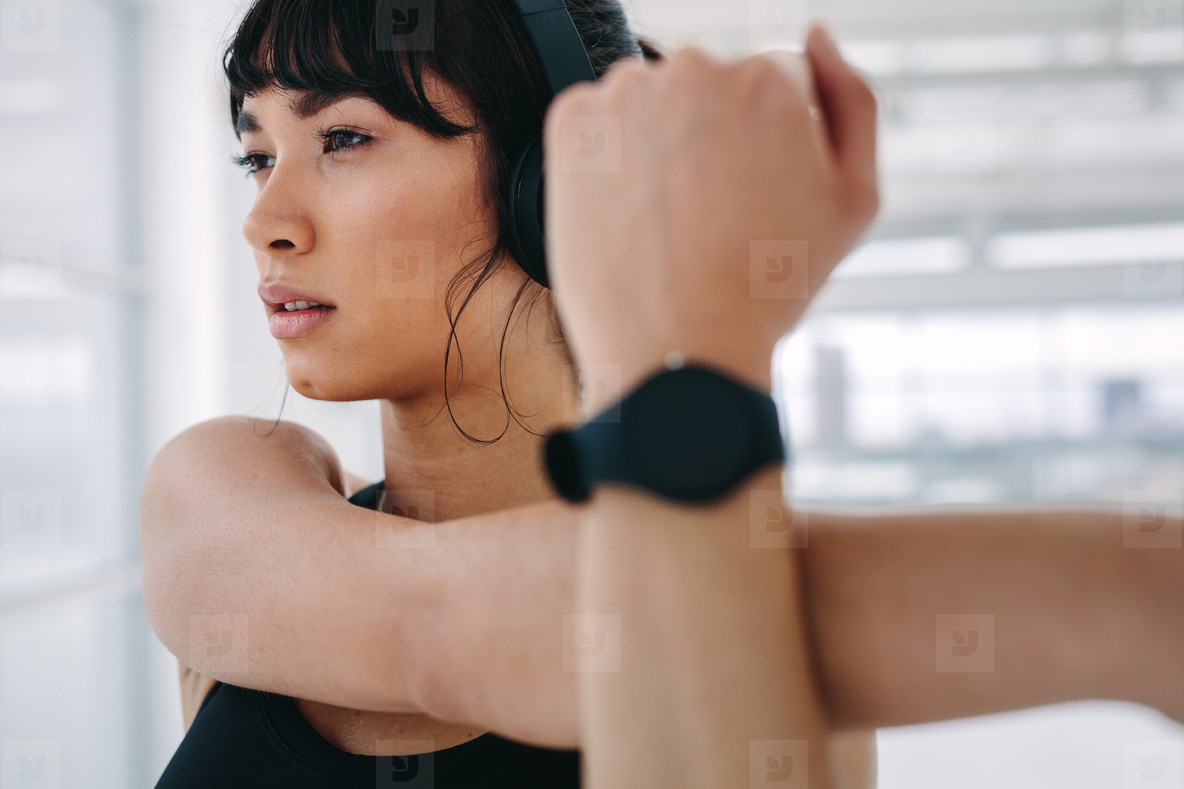Woman warming up before intense workout