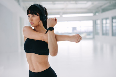 Woman doing warmup workout at fitness studio