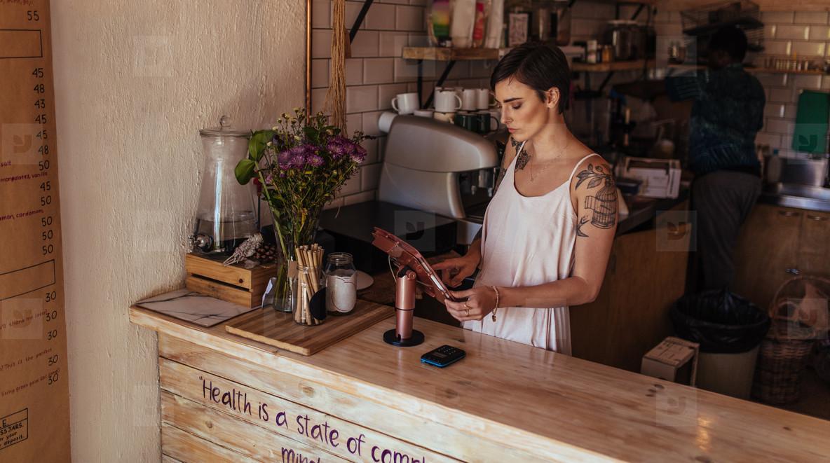 Woman entrepreneur at her coffee shop
