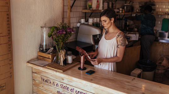 Woman entrepreneur at her coffee shop