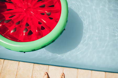 Inflatable watermelon floating mattress in pool