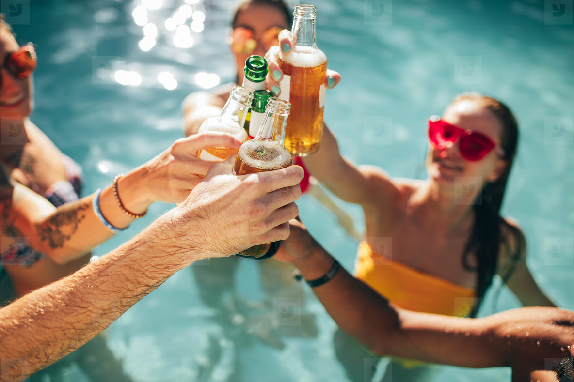 Photos - Friends at pool party having beers 142107 - YouWorkForThem