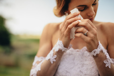 Emotional bride weeps tears of happiness