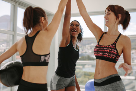 Girls high five after successful workout session