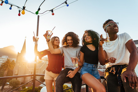 Group of friends having a rooftop party