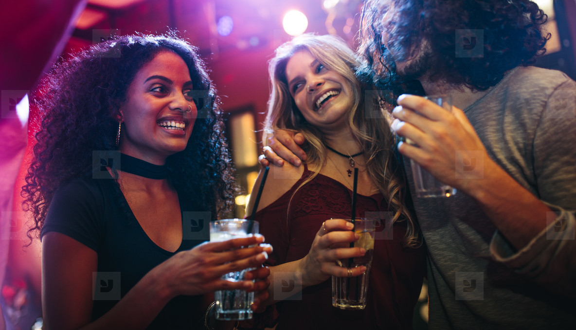 Group of friends enjoying at party in bar