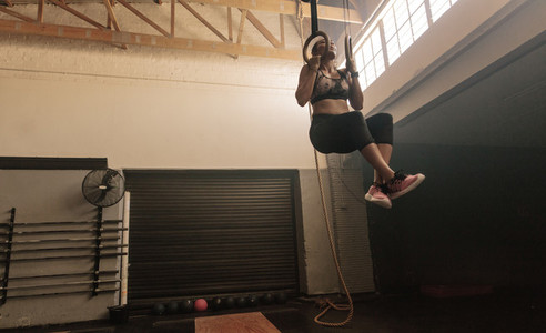 Woman doing workout on gymnastic rings