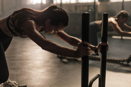 Women doing intense physical workout in gym