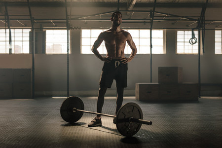 Muscular man after weight lifting workout in gym