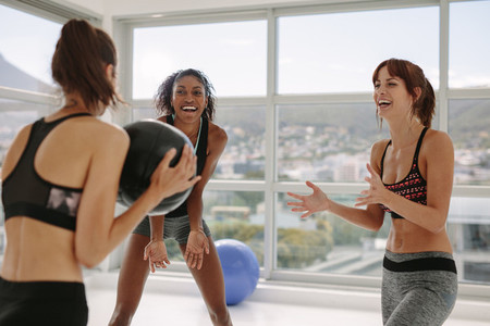 Sporty women exercising with medicine ball