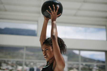 African woman training with fitness ball