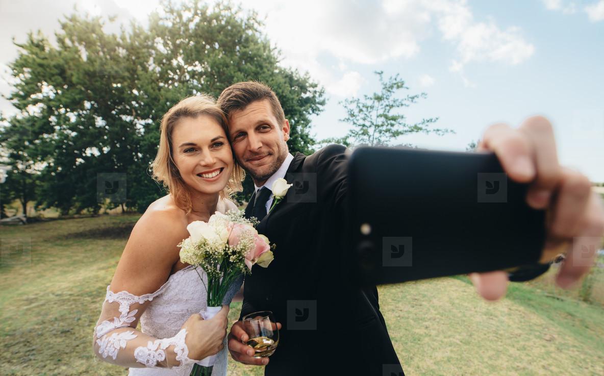 Wedding couple taking a selfie