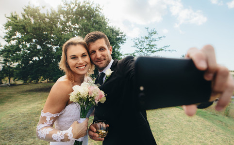 Wedding couple taking a selfie