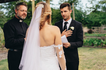Groom reading vows at his wedding