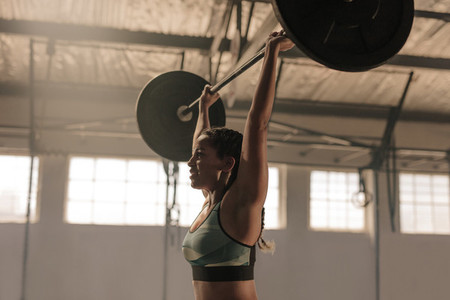 Female athlete lifting heavy weights