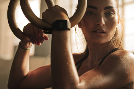 Fitness woman looking tired after intense workout