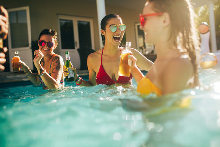 Group of women having party in a swimming pool