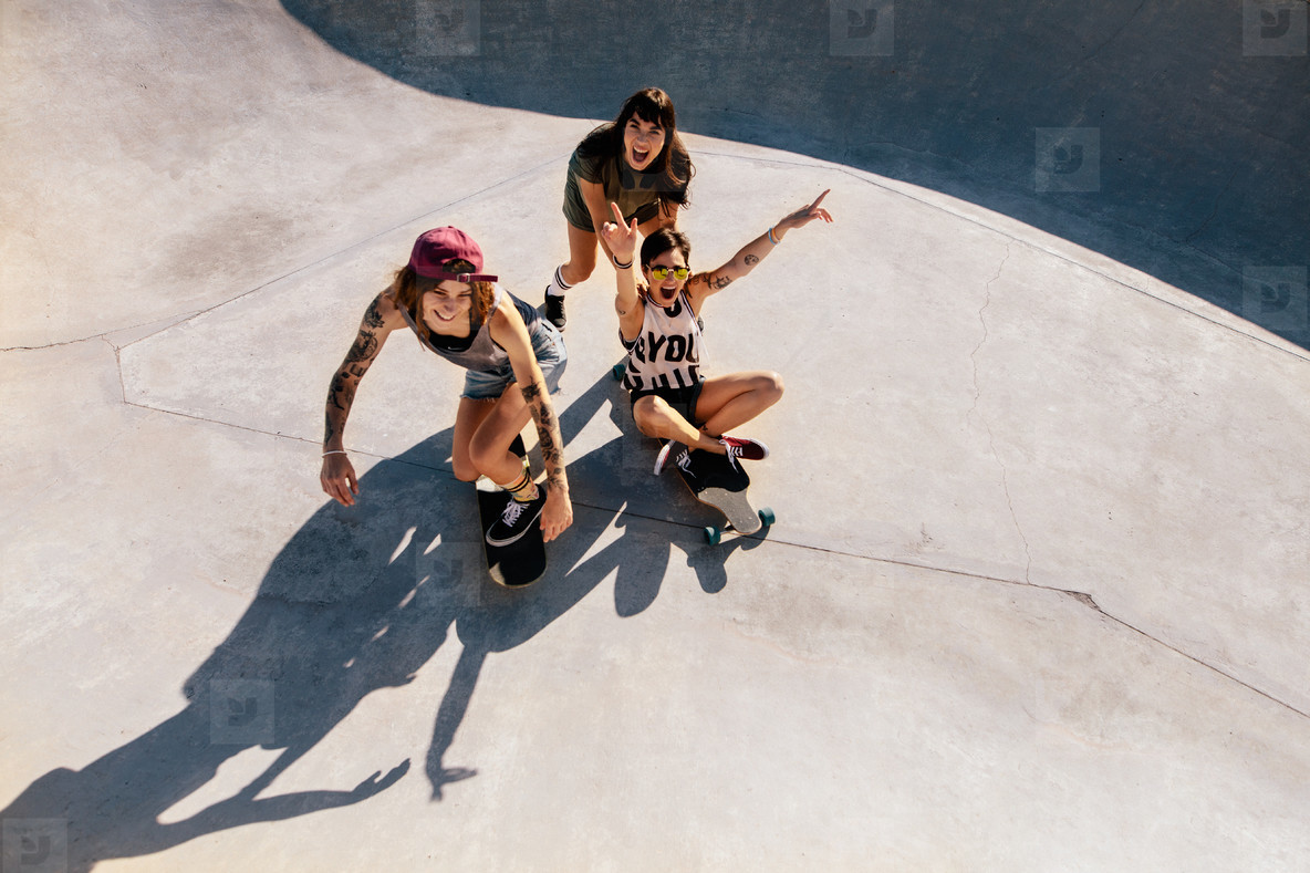 Girls enjoying skateboarding at skate park