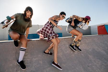 Female skaters having fun at skate park