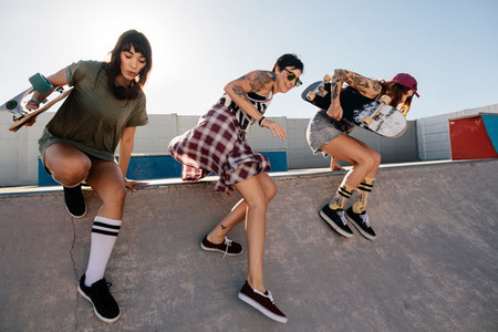 Female skaters having fun at skate park
