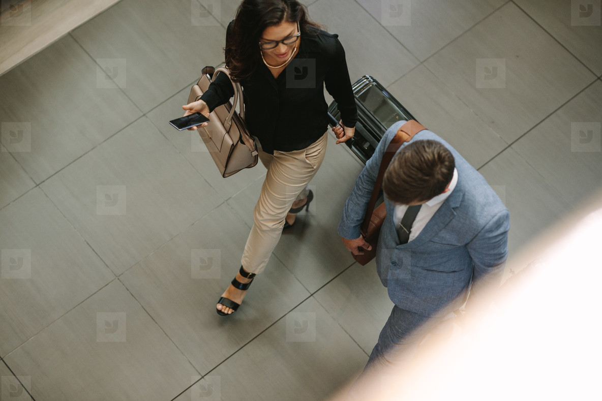 Business travelers walking together with luggage